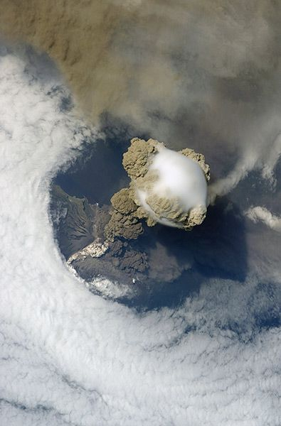 Credit: Science Photo Library / Rex Feat/Science Photo Library / Rex Feat Pileus cloud above the Sarychev volcano as it erupts, at the Kuril Islands, Russia. Pileus clouds are small clouds that form on top of a bigger cloud