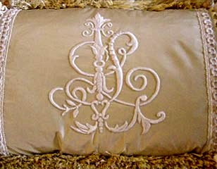 hand-embroidered padded satin-stitch monogram.   www.fineembroidery.net