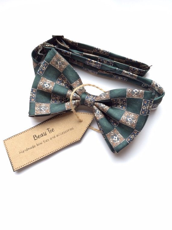 DESCRIPTION: This mens bow tie has been handmade using a dark green patterned vintage silk. It has a double bow and twisted central loop for that extra