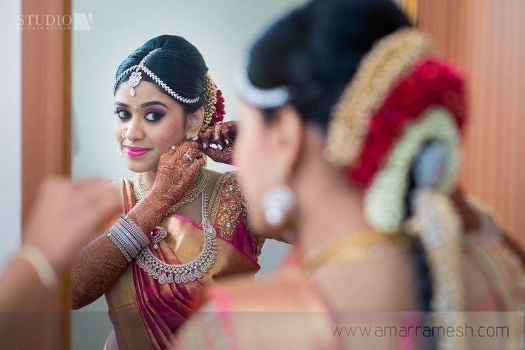 South Indian bride. Diamond Indian bridal jewelry. Temple jewelry.Jhumkis. Silk Kanchipuram silk saree with contrast embroidered pink blouse.Braid with fresh flowers. Tamil bride. Telugu bride. Kannada bride. Hindu bride. Malayalee bride.Kerala bride.South Indian wedding.