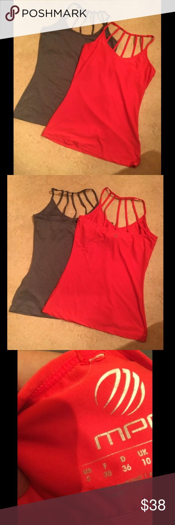 "(SALE!) 2 workout tank tops Size- Both small Condition- EUC (only flaw is the silver lettering is fading, but you can't really see it anyways) Color- Grey and bright redish  Stretchy   Built in bra   Inserts not included   Strappy back   Please submit all offers through the offer button! Unless marked ""NO OFFERS"". Low ball offers will be ignored.. ❤️  Thanks for looking! Tops Tank Tops"