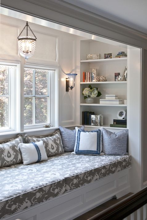 Built-in reading nook with ikat cushion. So sweet.