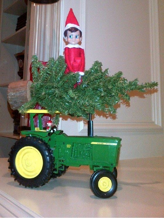 Our Elf on a Shelf made his grand reappearance for the holidays, arriving with a tree atop his John Deer tractor, driven by an elf.
