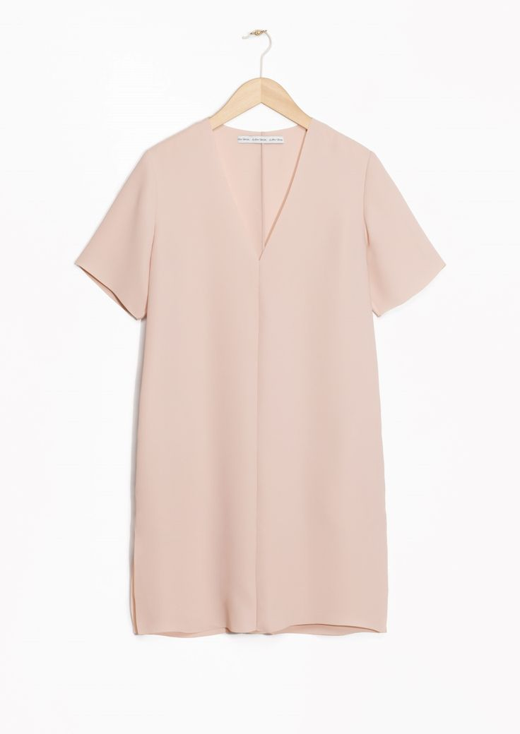 Nude simple dress with V-neck.