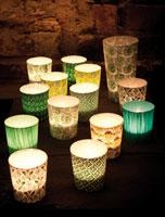 Decoupaging cool paper onto glass for tealights...