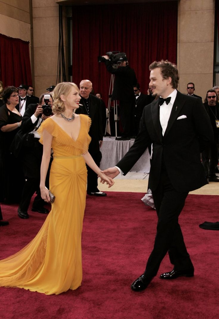 Michelle Williams & Heath Ledger - Oscars, March 5th 2006    I think this is one of the most iconic Oscar images that exists. Michelle in that feminine yet bold canary yellow Vera Wang gown with the classic red lips & soft waves in her hair, she looked so sweet, so ethereal. It's such a beautiful, natural pose they're striking & they both look so happy & smitten. It makes my chest ache.