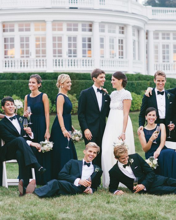 The groom, in Brooks Brothers, and the bride, in Jenny Packham, posed with their bridal party in front of her family's home. The bridesmaids sported navy blue Jenny Yoo gowns while the groomsmen donned classic tuxedos.