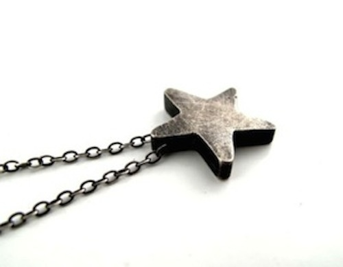 Love this super chunky silver star. Hand cast in sterling silver to create this simple and classic pendant. The pendant was given a black patina and then scrubbed with steel wool for a rustic scratched finish. Star measures approximately 3/4 inch in diameter. $62