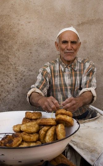 A man cooks  sfenji, a type of Moroccan donut