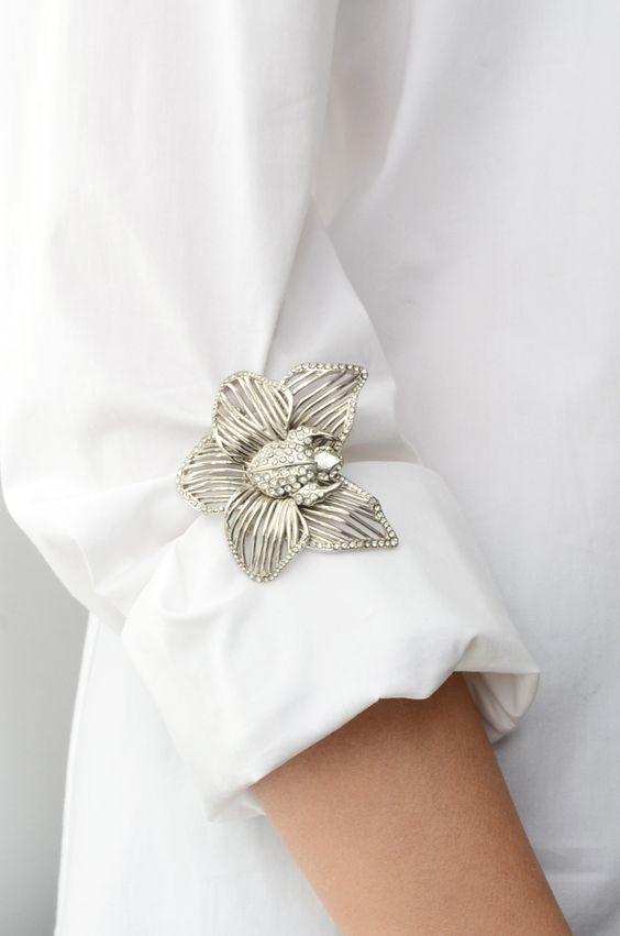 How to wear antique brooches(who would think of pinning one to cuff?) (visit site for other unique ideas)