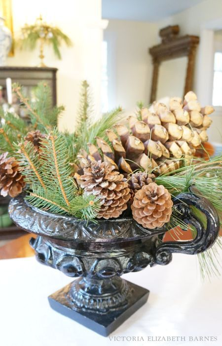 Scored these small antique urns on Craigslist for next to nothing!!! I filled them with lots of evergreens and HUGE pinecones for simple and lush holiday decor, and a fast Christmas tablescape.