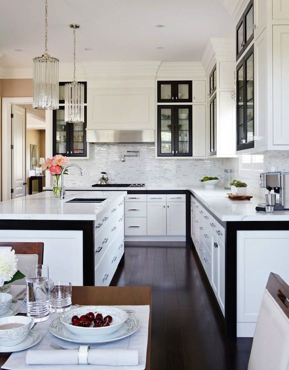 Gluckstein Home: Contemporary white and black kitchen design with floor to ceiling kitchen cabinets with ...