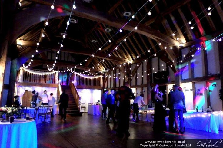 Oakwood Events festoon canopy by night, with extra lighting by resident DJ Mitch at the Tudor Barn Burnham