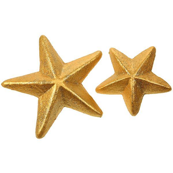 Kultaisella Inka Goldilla ja kimalleliimalla käsiteltyjä styrox-tähtiä.
