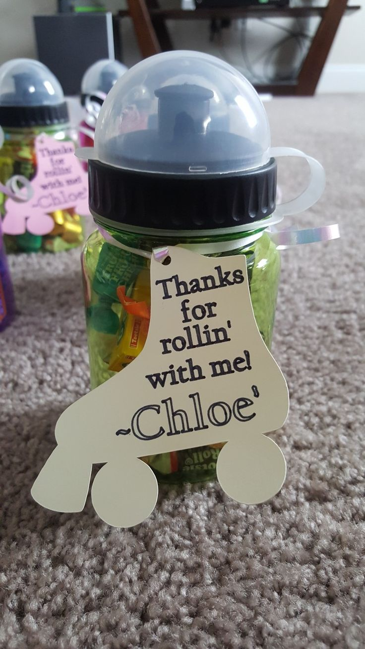 """Water bottle for roller skate party. Filled with tootsie roll, rolos, and a bouncy ball with a note stating """"thanks for rollin' with me!"""""""