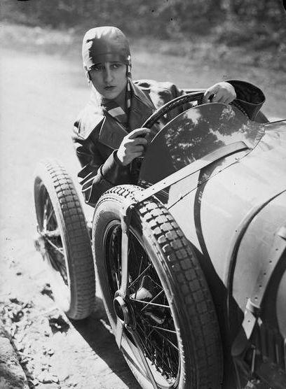 André Kertész     Young Woman in a Sports Car, Paris     1928