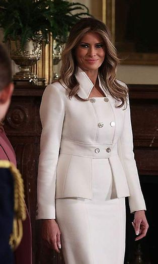 Melania Trump looked elegant in a bespoke Karl Lagerfeld Couture skirt suit for her first official appearance at the White House on Wednesday. The white cashmere suit featured a double breasted jacket with statement collar and silver button detailing, and a matching pencil skirt.  The First Lady, who had previously been rumoured to wear an outfit from the designer at the inauguration, styled the ensemble with white court shoes and wore her hair down in loose waves.  Photo: ©...