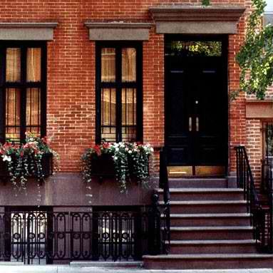 Greenwich Village, red brick, black door, black window frames, window flower boxes, flower boxes, curb appeal, New York, brownstone