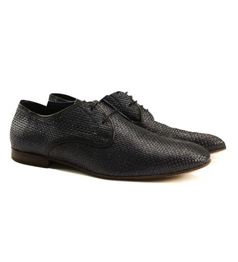 Vince Raffia Shoe by Tiger of Sweden $229 | The design team at Tiger of Sweden have created the ultimate classic shoe. The Vince Raffia shoe is basket-woven, with contrast piping and round, waxed laces. Easily channel timeless elegance for semi-formal summer events. | GOTSTYLE.ca