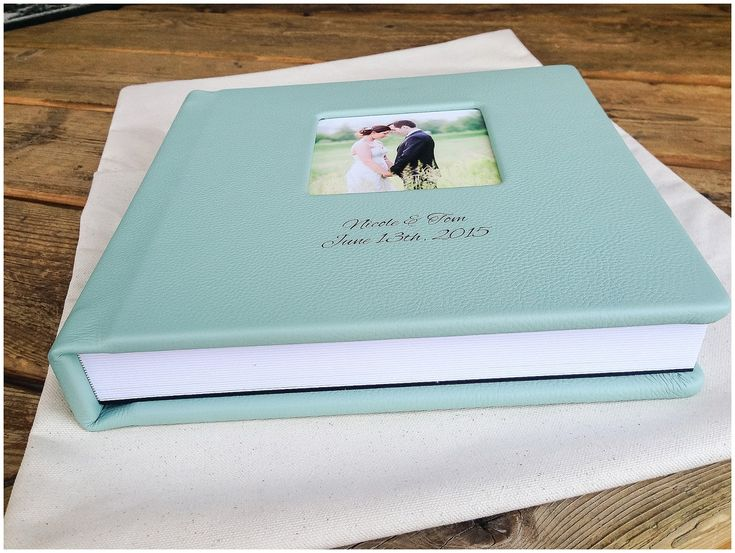 Wedding album cover in aquamarine leather with cameo window and engraving by KISS Books