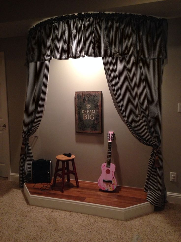 Playroom stage with curtains.