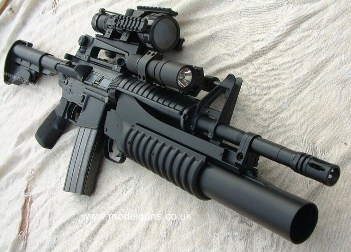 M4 Carbine....my weapons in the military were the M16 with the 203 grenade launcher & a 9mm beretta.