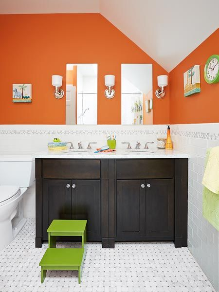 Narrow frameless-mirror medicine cabinets and a trio of sconces keep this kids' bath feeling light and bright. | Vanity: Woodpro; creativekandb.com | Sconces: @hudsonvalleylgt | Medicine cabinets: @robernco | Photo: Mark Lund