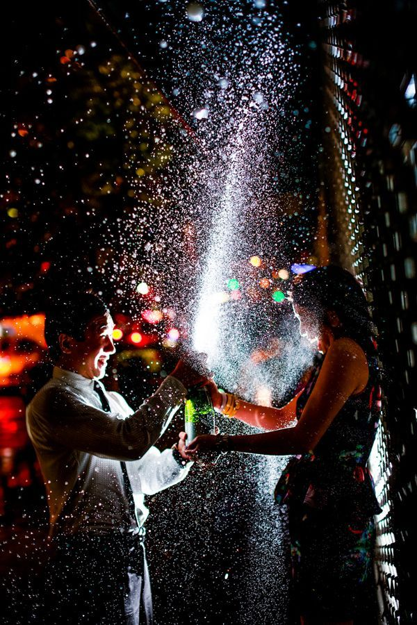 Spraying champagne engagement photo! Engagement Shoot Inspiration: 15 Couple Poses You've Just Got To Try!