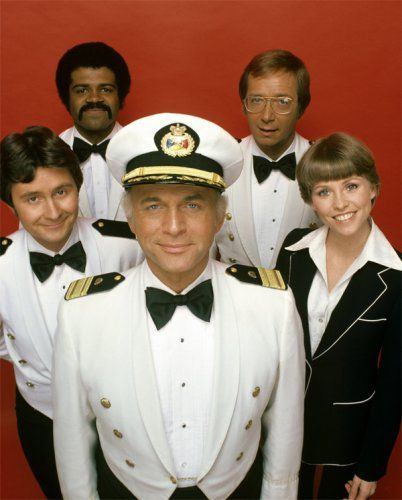 """The Love Boat cast  (September 24, 1977 – May 24, 1986) Ted Lange as Isaac Washington, """"Your Bartender"""", Bernie Kopell as Dr. Adam """"Doc"""" Bricker, """"Your Ship's Doctor"""", Fred Grandy as Burl """"Gopher"""" Smith, """"Your Yeoman Purser, Gavin MacLeod as Captain Merrill Stubing, """"Your Captain"""" and Lauren Tewes as Julie McCoy, """"Your Cruise Director"""""""