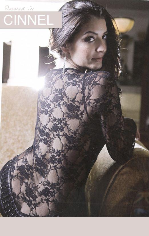 Jeannie D wearing a black lace dress
