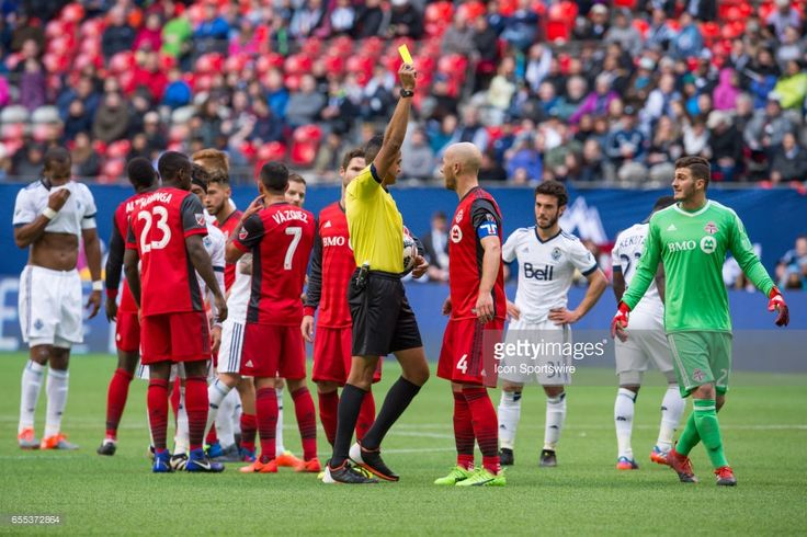 Referee shows a yellow card to Toronto FC midfielder Michael Bradley (4) during their match against the Vancouver Whitecaps at BC Place on March 18, 2017 in Vancouver, Canada. Toronto won 2-0