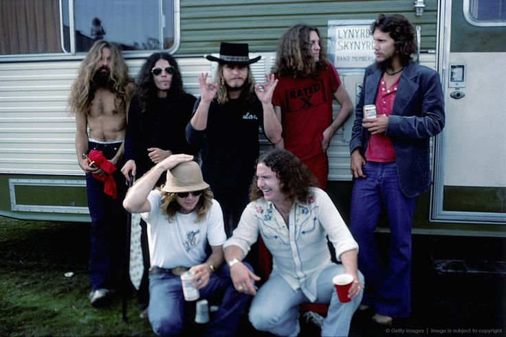 -CALIFORNIA - OCTOBER 1976: Southern Rock band Lynyrd Skynyrd (L-R back row Artimus Pyle, Gary Rossington, Ronnie Van Zant, Allen Collins and Steve Gaines, front row Leon Wilkeson and Billy Powell) pose by their trailer backstage at an outdoor concert in October, 1976 in California.