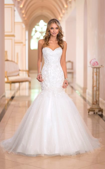 This fit and flare wedding dress from the Stella York collection features Lace applique on crystal beaded Tulle. Exclusive fit and flare wedding dresses by Stella York.