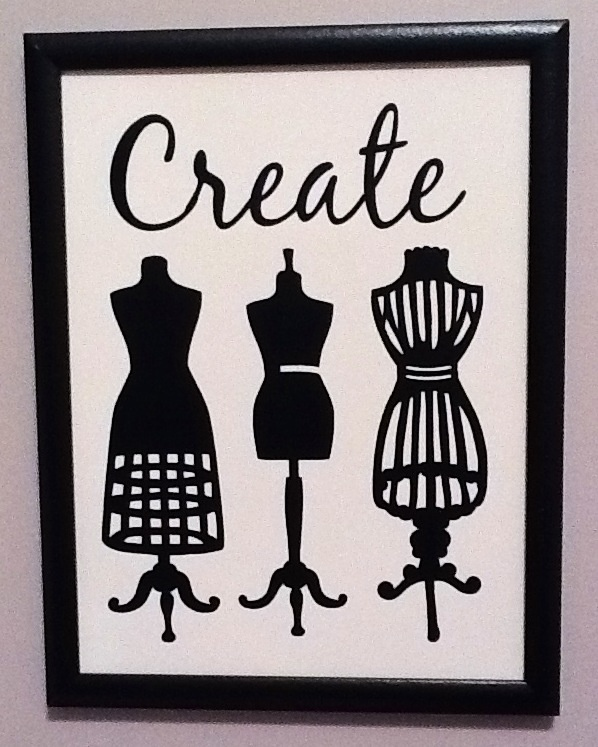 Inexpensive (really... target $1.00 bin dry erase board) 'art' for my sewing room. Love!  So happy with how it turned out. I adore my silhouette cameo cutter!!