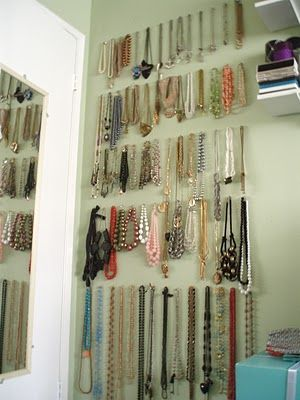 utilize wall space behind a door - push pins or command hooks to hang jewelry