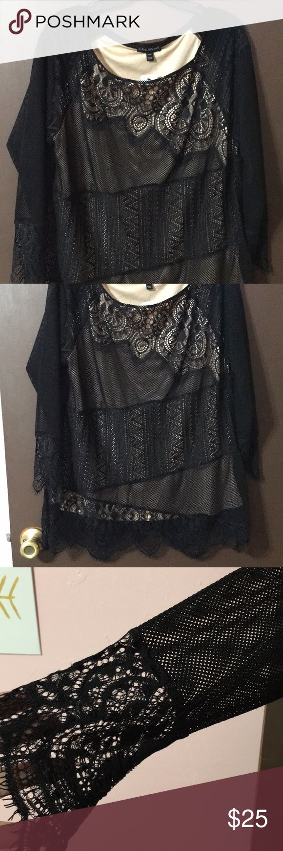 NWT Lane Bryant top NWT Lane Bryant black and cream lace top. Fully lined body and sheer lace sleeves. Size 14/16 Lane Bryant Tops