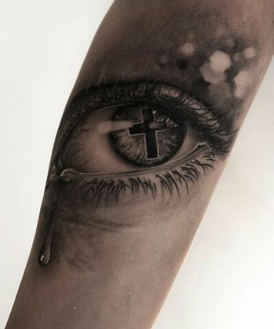 Cross and eye tattoo
