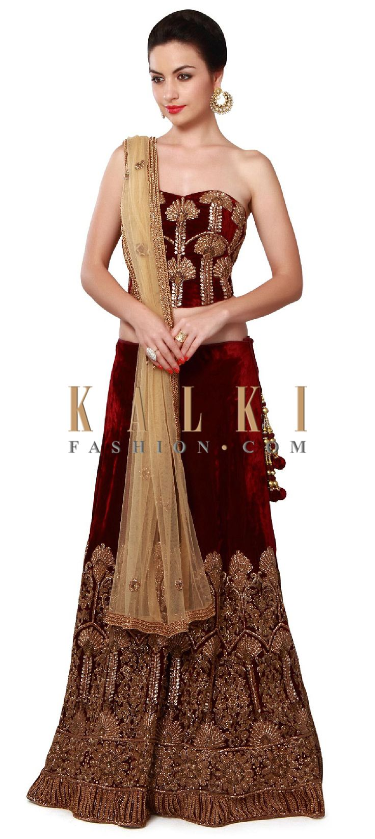 Buy Online from the link below. We ship worldwide (Free Shipping over US$100). Product SKU - 272283. Product Price - $2,359.00. Product link - http://www.kalkifashion.com/maroon-lehenga-matched-with-corset-blouse-only-on-kalki.html