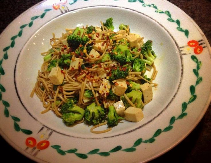 Ginger poached soba noodles with broccoli and tofu sprinkled with ...