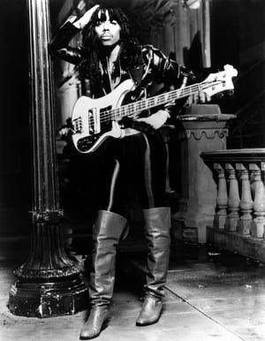 "Rick James ((February 1, 1948 – August 6, 2004) was an American musician, composer and actor. hit singles, ""Give It to Me Baby"" and ""Super Freak"","