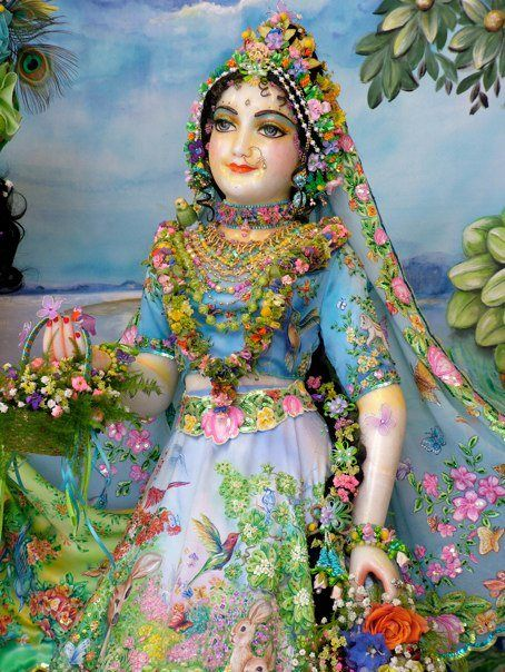 "Sri Prarthana-paddhati [Stavamala]  ~""O Queen of Vrndavana, O Radharani, Your complexion is like molten gold, Your doe-like eyes are captivatingly restless, a million full and brilliant moons wane before Your lustrous countenance, and a blue sari, having stolen the hue of a fresh rain-laden cloud, has enwrapped Your exquisite form. O Radha, You are the crest-jewel of all the dallying damsels of Vrndavana, fragrant and pristine like a budding jasmine flower. Your sublime form is adorned with"