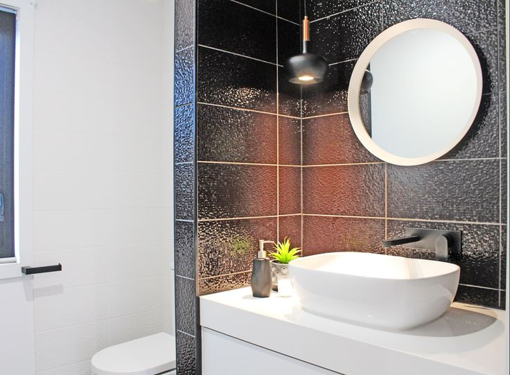 "Statement Black & White Powder Room. Get the look: Custom made stone & painted Vanity Unit - Romandini Cabinets Tap-ware, sink & toilet - Kalessi Bathroomware Black & copper pendant light - Beacon Lighting Textured gloss tiles ""Hypercube"" - Beaumont Tiles Vic."