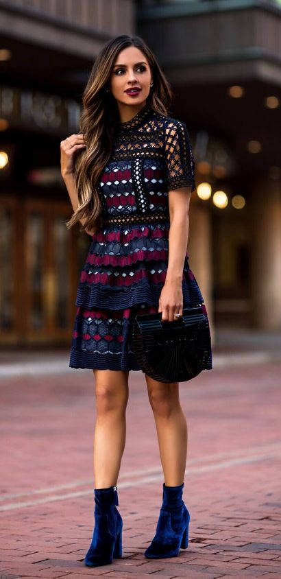 Dark blue lace dress. Perfect for Christmas dinner . More of winter/fall dress because of the dark colors. If the boots aren't you change them for skin tone heel. Keep them simple.