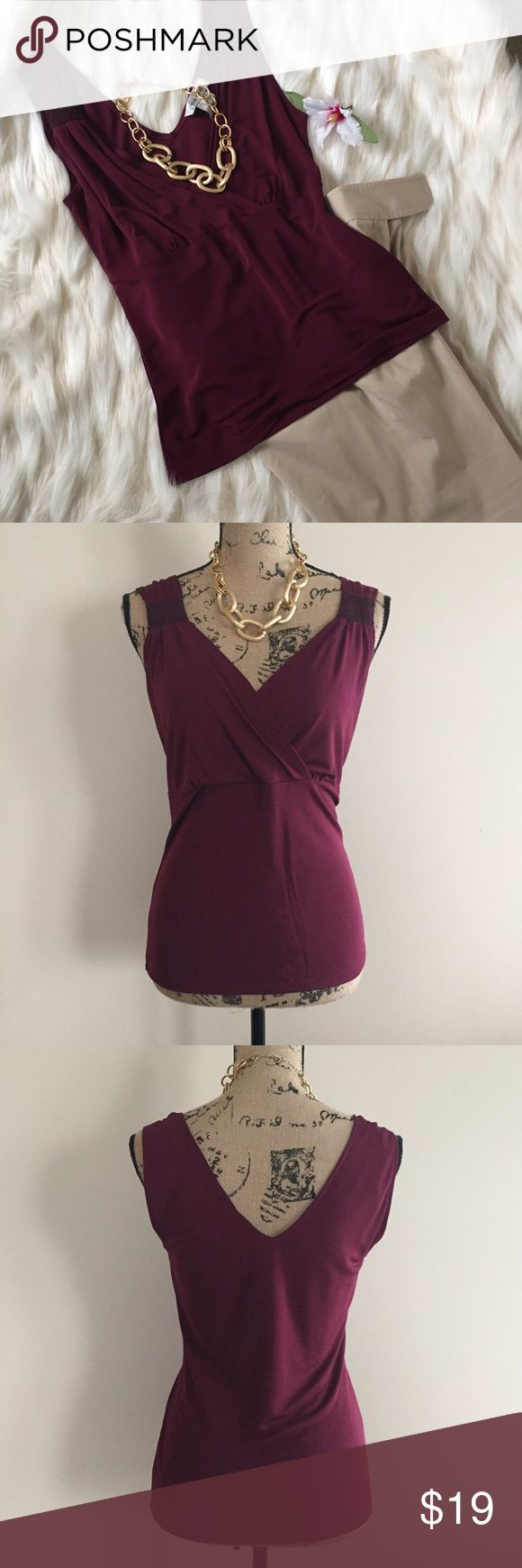 👠 Nine West cranberry tank 👠 Pretty cranberry tank from Nine West has a tucked and seamed bust line adding a feminine look. Brown crisscrossing detailing at shoulders. Size S. Excellent condition. Nine West Tops Blouses