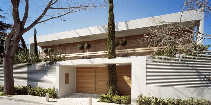 Villa 153 / ISV Architects  Love the outer wall and entry to the building. Love the incorporation of existing trees