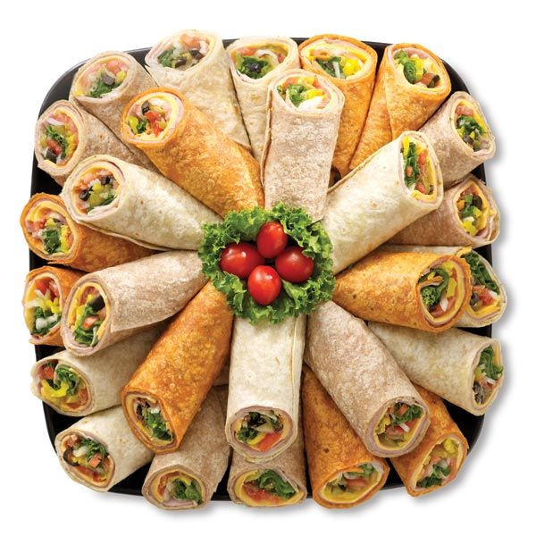 Wraps (wrapped tightly and secured) sliced into finger foods