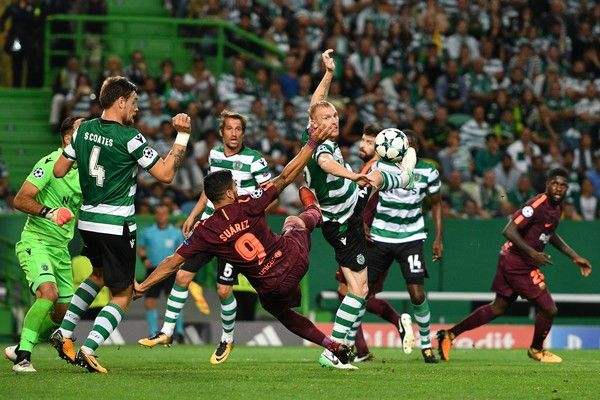 Jeremy Mathieu  of Sporting CP competes for the ball with Luis Suarez of FC Barcelona during the UEFA Champions League group D match between Sporting CP and FC Barcelona at Estadio Jose Alvalade on September 27, 2017 in Lisbon, Portugal.