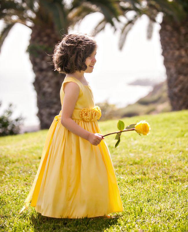 Bright yellow flower girl dress looks like belle. Maybe put Eleni in yellow??