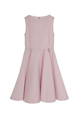 Pink Pique Dress. A perfect summer dress for all occasions. This luxurious sleeveless pique dress in a soft pink comes adorned with a beautiful button detail running from neck to waist at the rear. It has a full, circular skirt to create a graceful silhouette. Perfect for any little lady! Outer 59% Acrylic, 24% Polyester, 17% Viscose. Lining: 100% Polyester. Gentle Dry Clean only.