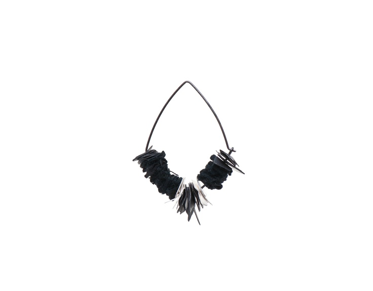 Earring by Ellie Mücke and Emma Grace (Sterling silver, oxidised sterling silver, reclaimed fabric)